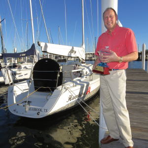 "Lakewood Yacht Club racer Al Goethe holds his ""Yacht of the Year"" award alongside his J/105 ""Hamburg."""