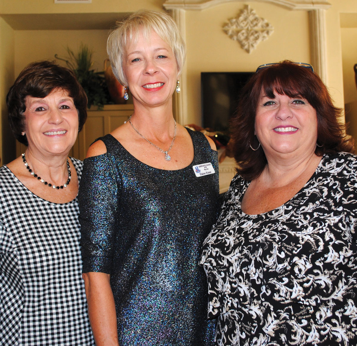 Hostess Elaine Rister, center, thanks Suzanne Stephens, right, for chairing the Assistance League Holiday Open House at her Bay Oaks home in Clear Lake.