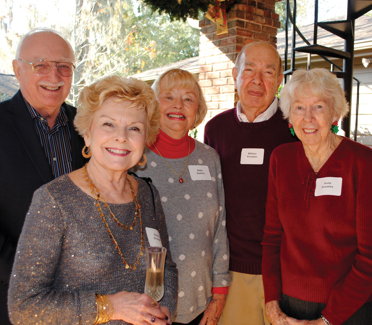 Houston Symphony League Bay Area members Bill and Sherry Straight, Betty Geehan and Bill and Anita Knowles, from left, enjoy the gorgeous weather out on the patio at their annual Holiday Brunch.