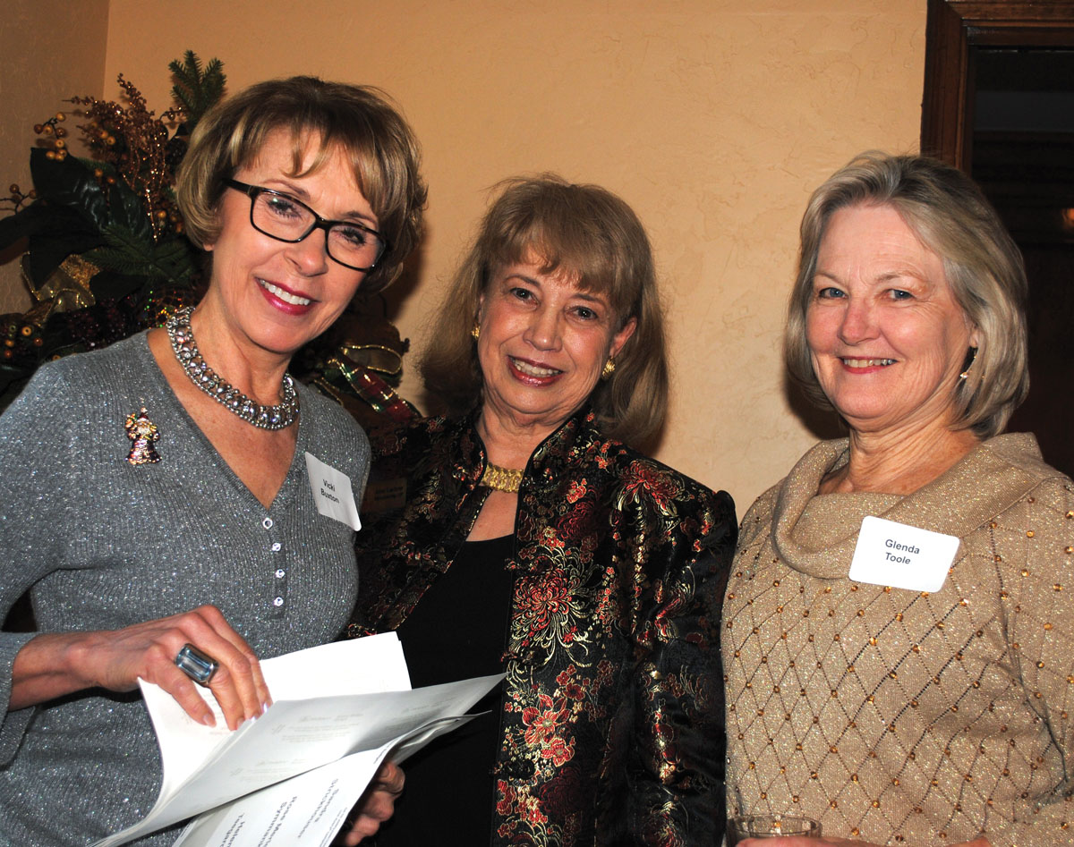 Vicki Buxton, Jane Lackow and Glenda Toole, from left, ready plans for the Houston Symphony League Bay Area's annual Home Tour while enjoying the group's Holiday Brunch.