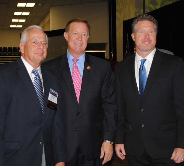 Economic Alliance President and CEO Chad Burke, right, welcomes Congressmen Gene Green, left, and Randy Weber, speakers at the 5th Annual Maritime & Petrochemical Outlook Conference at the Pasadena Convention Center.