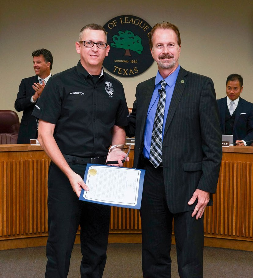 League City Mayor Tim Paulissen presents Jack Compton with the Arthur Hewitt Volunteer Spirit Award during the Aug. 25 City Council meeting for his continuous support and volunteer work with the City's Police Department. (Photos by Quan Robinson)