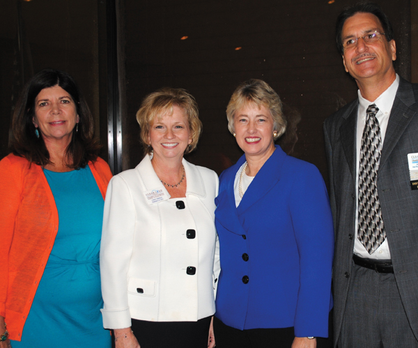 Houston Mayor Annise Parker, third from left, stops for a photo with Clear Lake Area Chamber Chairman Mike Furin and President Cindy Harreld, second from left, after addressing the chamber at Lakewood Yacht Club. At left is Kippy Caraway of Clear Lake, the mayor's deputy chief of staff.