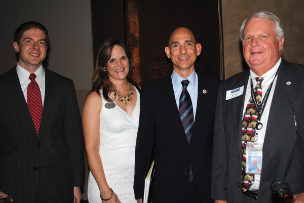 State Rep. Dr. Greg Bonnen, center, and his wife, Kim, stop to talk with Harris County Director of Transit Services Ken Fickes, right, and Boeing Government Operations Manager Brian Freedman as they join the crowd at the Bay Area Houston Transportation Partnership reception at Cullen's Upscale Grille.