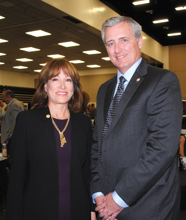 Port Commission Chairman Janiece Longoria and Port Executive Director Col. Len Waterworth look for their table as they join the crowd at the Economic Alliance Petrochemical and Maritime Outlook Conference.