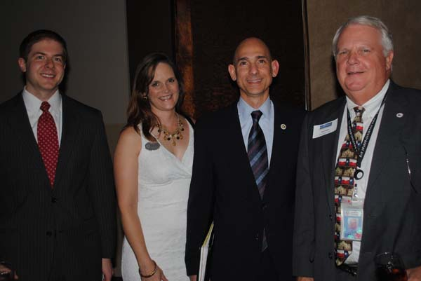 State Rep. Dr. Greg Bonnin, center, and his wife, Kim, stop to talk with Harris County Director of Transit Services Ken Fickes, right, and Boeing Government Operations Manager Brian Freedman as they join the crowd at the Bay Area Houston Transportation Partnership reception at Cullen's Upscale Grille.