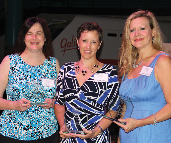 Volunteer Hall of Fame award winners for 2013 Cathy Pincus, Dawn Kopra and Kathy Pubentz, from left, get together for a photo after the presentation.