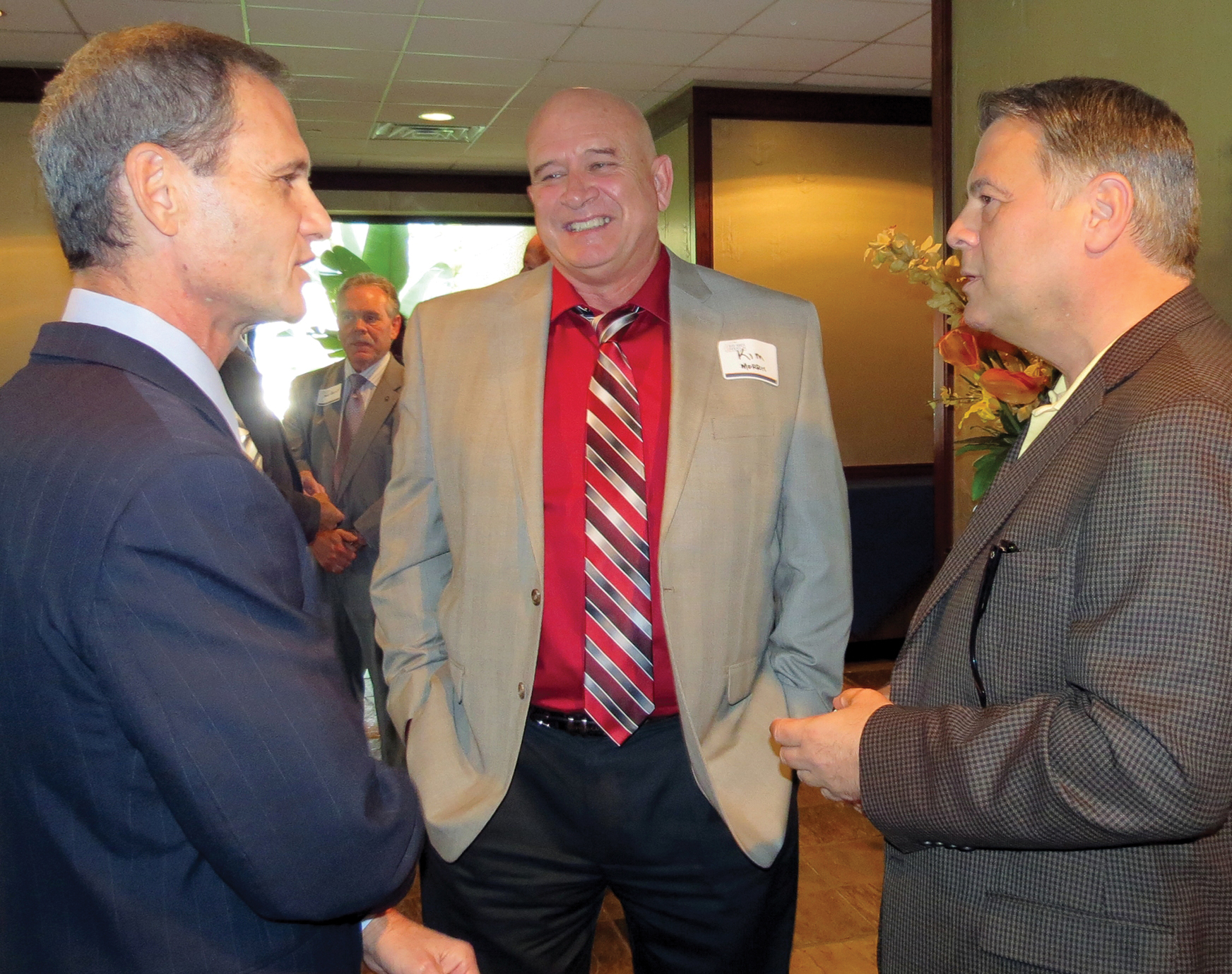 Bay Tech Director Kim Morris, center, talks with George Abbey Jr., right, and Intuitive Machines Executive Vice President Mark Gittleman.