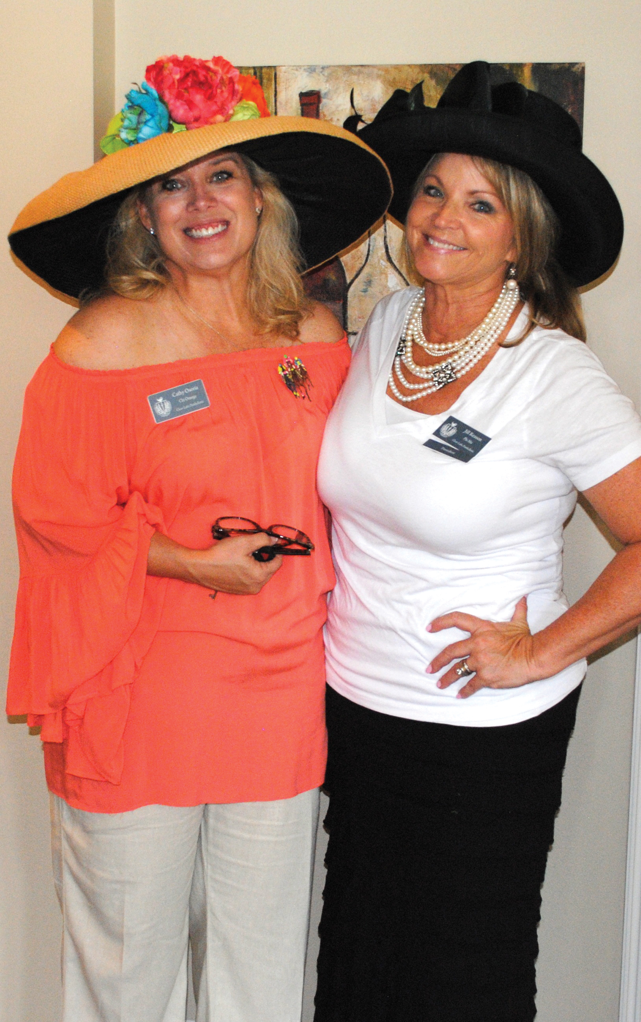 Clear Lake Area Panhellenic President Jill Reason, right, and hostess Cathy Osoria prepare to welcome the crowd to the Fall Friendship Tea.
