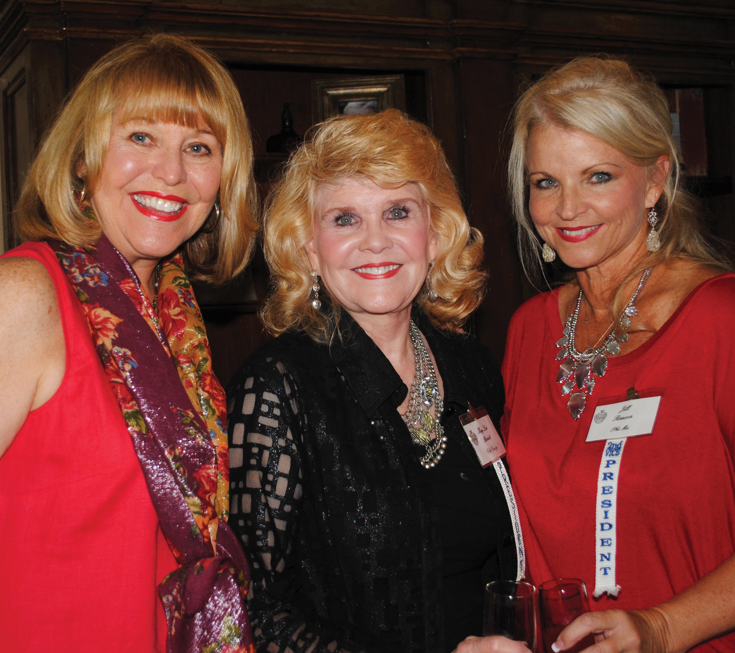 Clear Lake Panhellenic President Kay Lee Benoit, center, was at the door to welcome members to their annual Fall Friendship Tea, along with Jo Nell Hunter, left, and Second Vice President Jill Reason