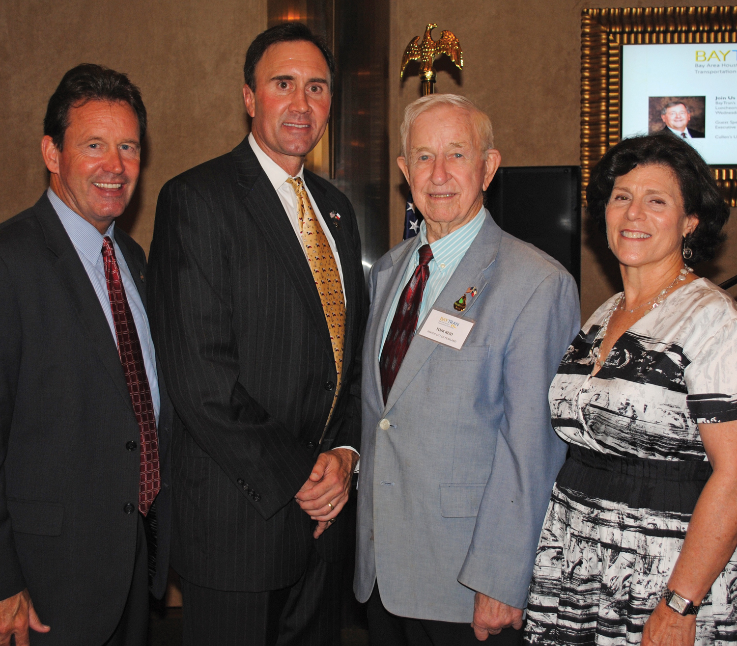Congressman Pete Olson, second from left, stops for a photo with, from left, Pearland Deputy City Manager Jon Branson and Mayor Tom Reid, plus Bay Area Houston Transportation Partnership President Barbara Koslov, after speaking at the BayTran monthly luncheon.