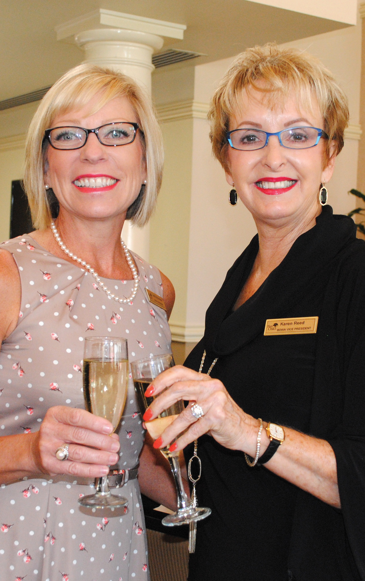 Fashion Show Chairman Karen Reed, right, receives congratulations from Bay Area Women's Association President Jodie Schnabel on another successful event.