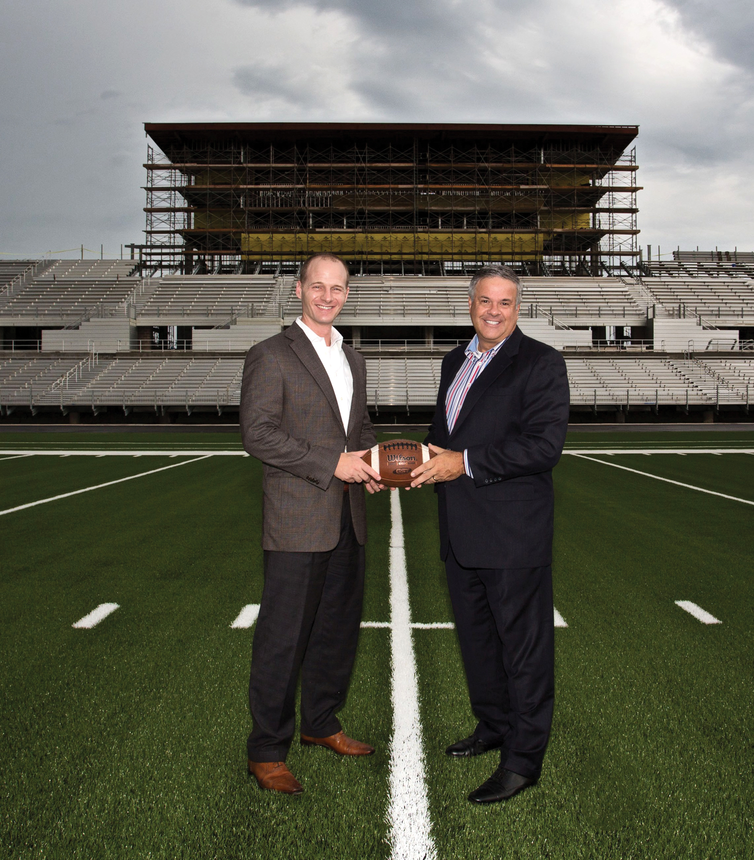 Houston Methodist St. John Hospital CEO Dan Newman, left, gets a look at the new Clear Creek ISD Challenger Columbia Stadium from the 50-yard line with CCISD Superintendent Dr. Greg Smith.