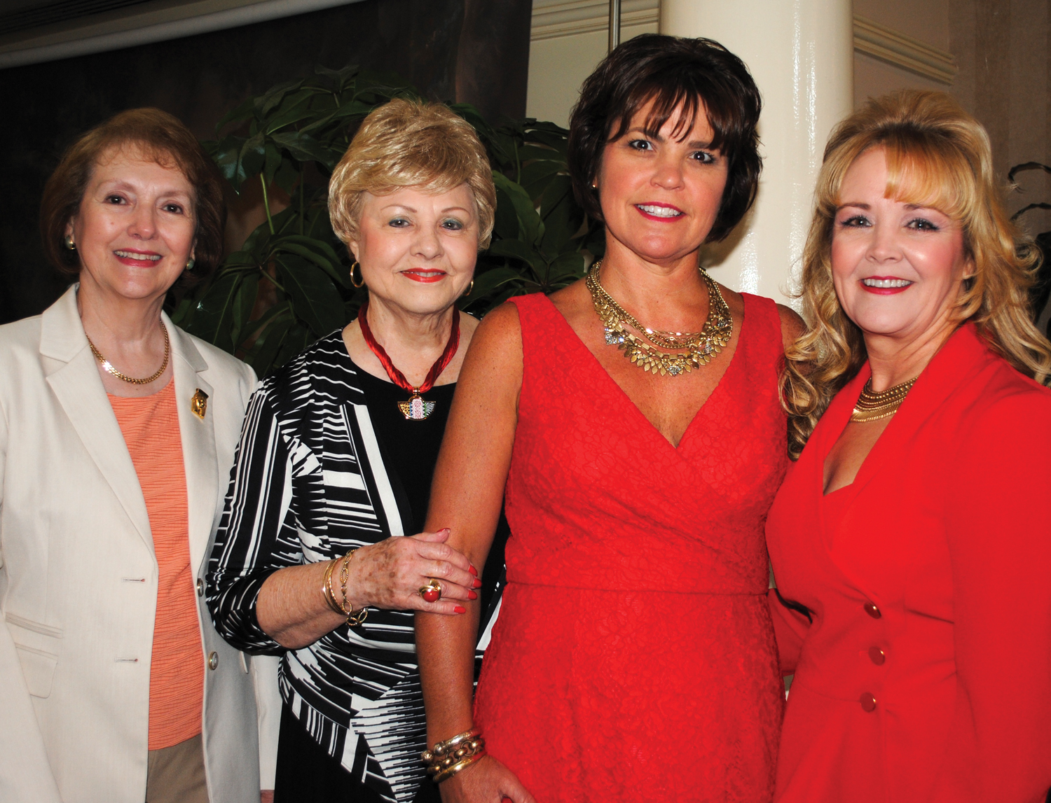 Jackie Daley, Virginia Hosea, Betsy Salbilla and Ann Brady, from left, stop for a photo as they arrive at Bay Oaks for the BOWA style show luncheon.
