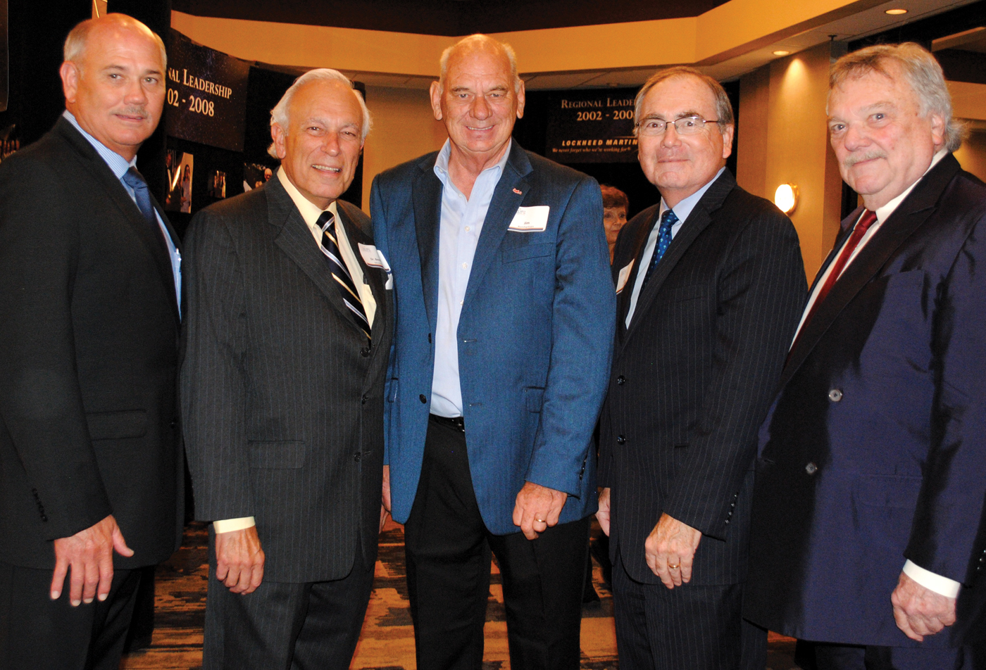 Jim Reinhartsen, center, who served as president of the Bay Area Houston Economic Partnership for 16 years, gets a warm welcome back from current BAHEP President Bob Mitchell, former Chairmen Dr. Bernard Milstein and Dr. William Staples and long-time board member, attorney Dick Gregg Jr., , from left, during BAHEP's 40th Anniversary Celebration.