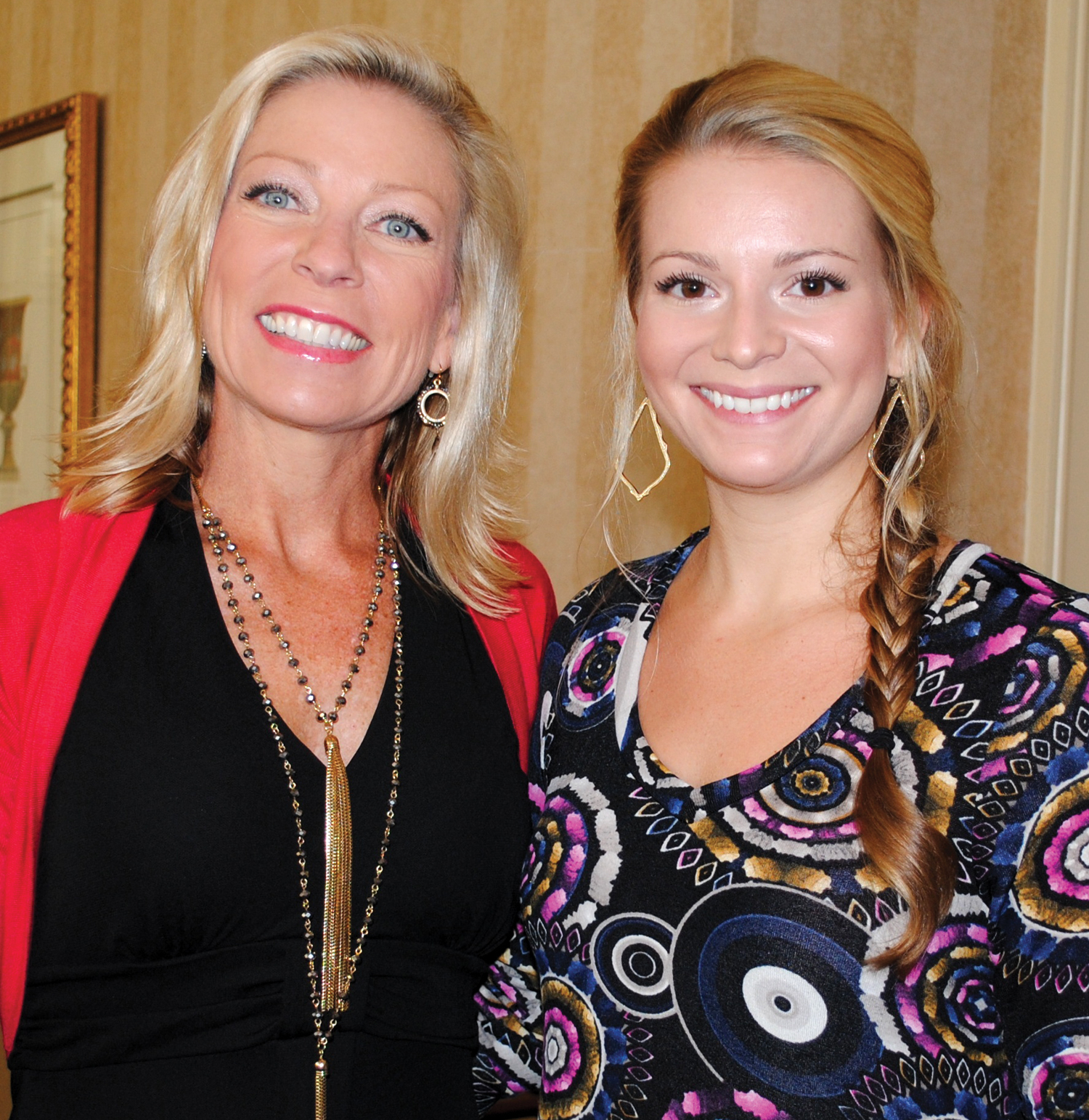 Jodie Schnabel, left, and Tori Buttle look for their table at the Bay Oaks Women's Association style show luncheon.