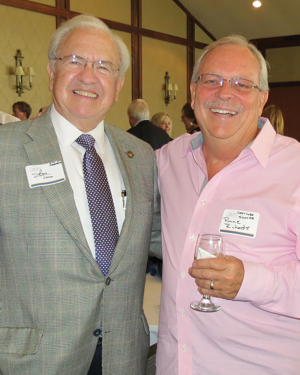 Pasadena Director of Economic Development Paul Davis, left, shares a light moment with Clear Lake Shores Director of Economic Development Ronnie Richards during BAHEP reception.