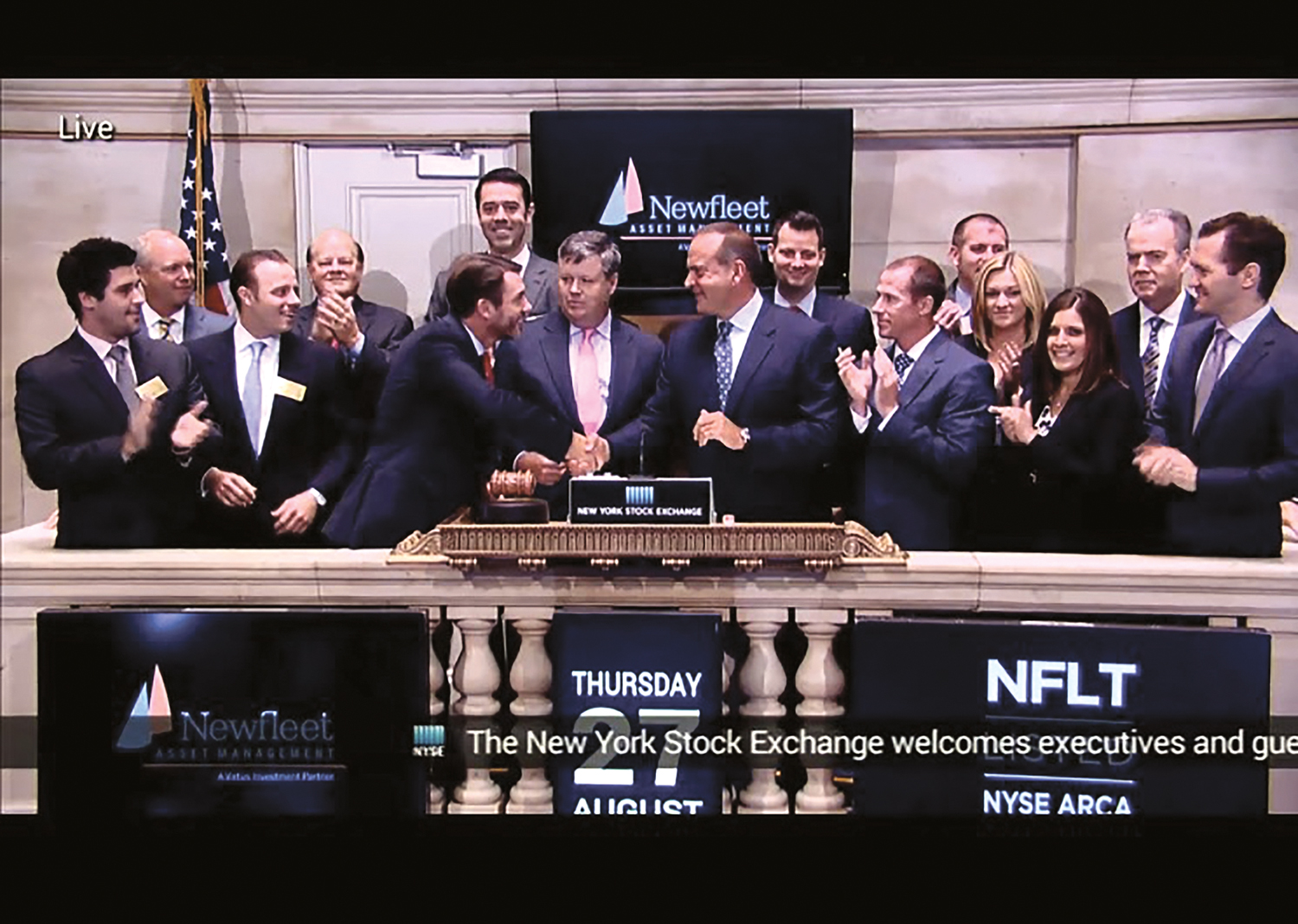 Paul Roberts, fourth from left, founder of Roberts Wealth Management in League City, claps as the bell rings on the New York Stock Exchange. His business was recently featured in Forbes Magazine.