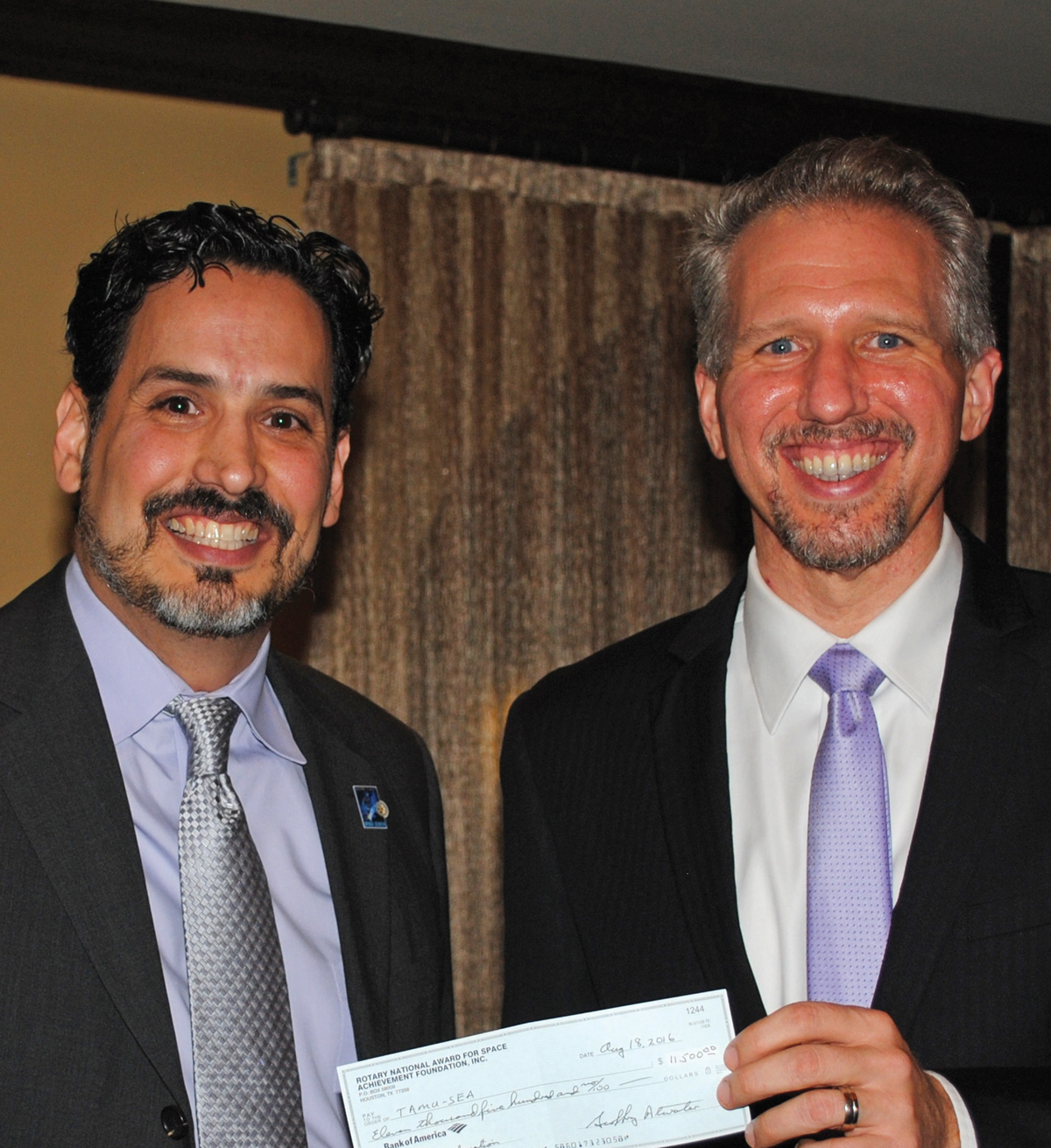 RNASA President Rodolfo Gonzalez, left, presents Mark Wright a check for $11,500 for the Texas Aerospace Scholars Program during Appreciation Dinner.