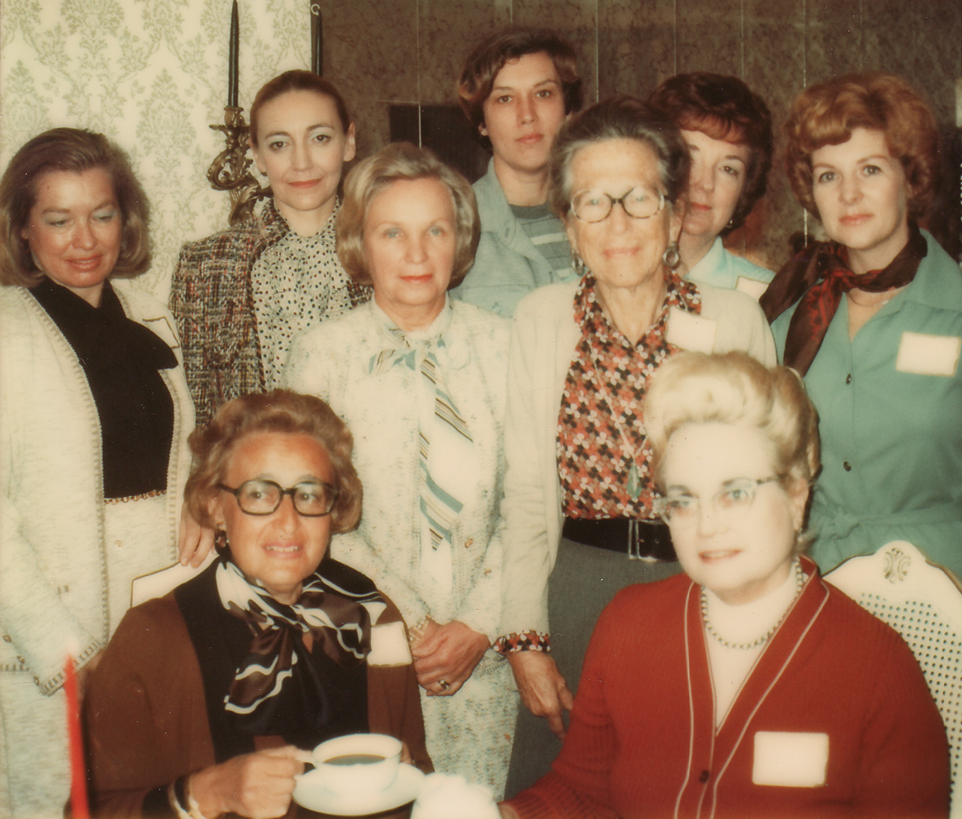 Symphony League Bay Area founders pose for a photo at the initial meeting of the chapter Jan. 17, 1976 at the home of Mrs. Brian Merrill, Clear Lake City. They are, from left, seated, Mrs. Alfred Neumann (Selma); Mrs. Brian Merrill (Loraine); standing, Mrs. Donald W. Gibson (Pat); Mrs. William Calvin Cannon (Alda); Mrs. William O. Strong Jr. (Fran); Mrs. Martin Arisco (Peggy); Mrs. Howard T. Barkley Sr. (Margaret); Mrs. Buford A. Wells (Julia Stark); and Mrs. Lewis Wade (Joan).