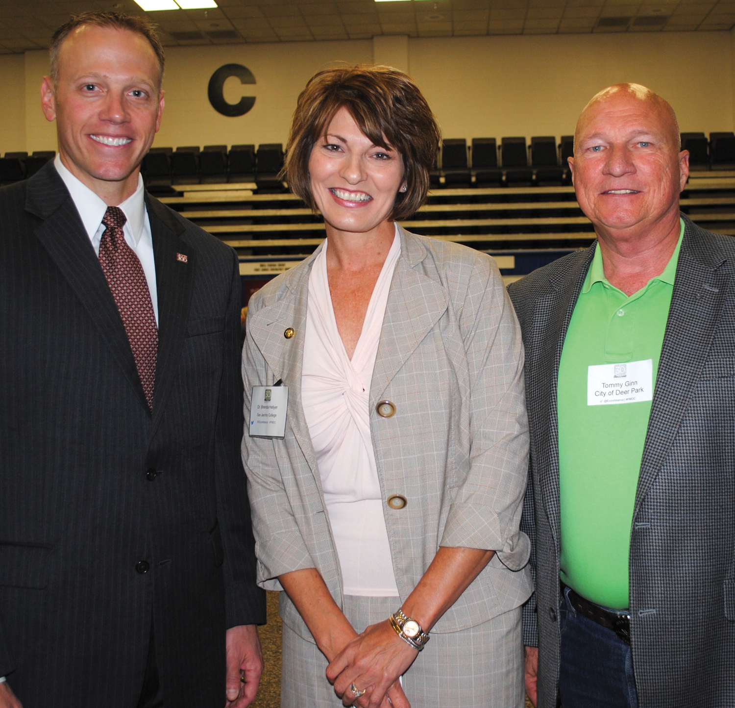 Texas Railroad Commissioner Ryan Sitton of Friendswood, left, receives compliments on his speech at the Economic Alliance conference from San Jacinto College Chancellor Dr. Brenda Hellyer and Deer Park Councilman Tommy Ginn.