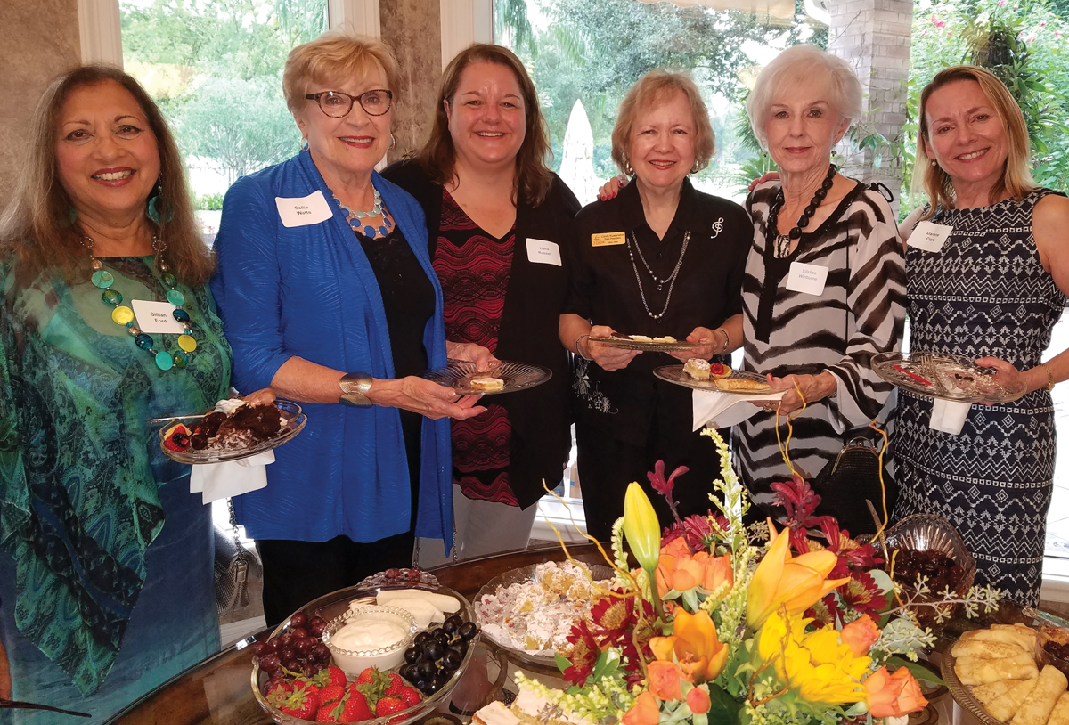There were smiles aplenty as the Houston Symphony League Bay Area hosted its annual Wine and Cheese Party, including those of Gillian Ford, Sallie Watts, Liana Russell, Cindy Kuenneke, Sisbee Winburne and Darlene Clark, from left, as they lined up for refreshments.