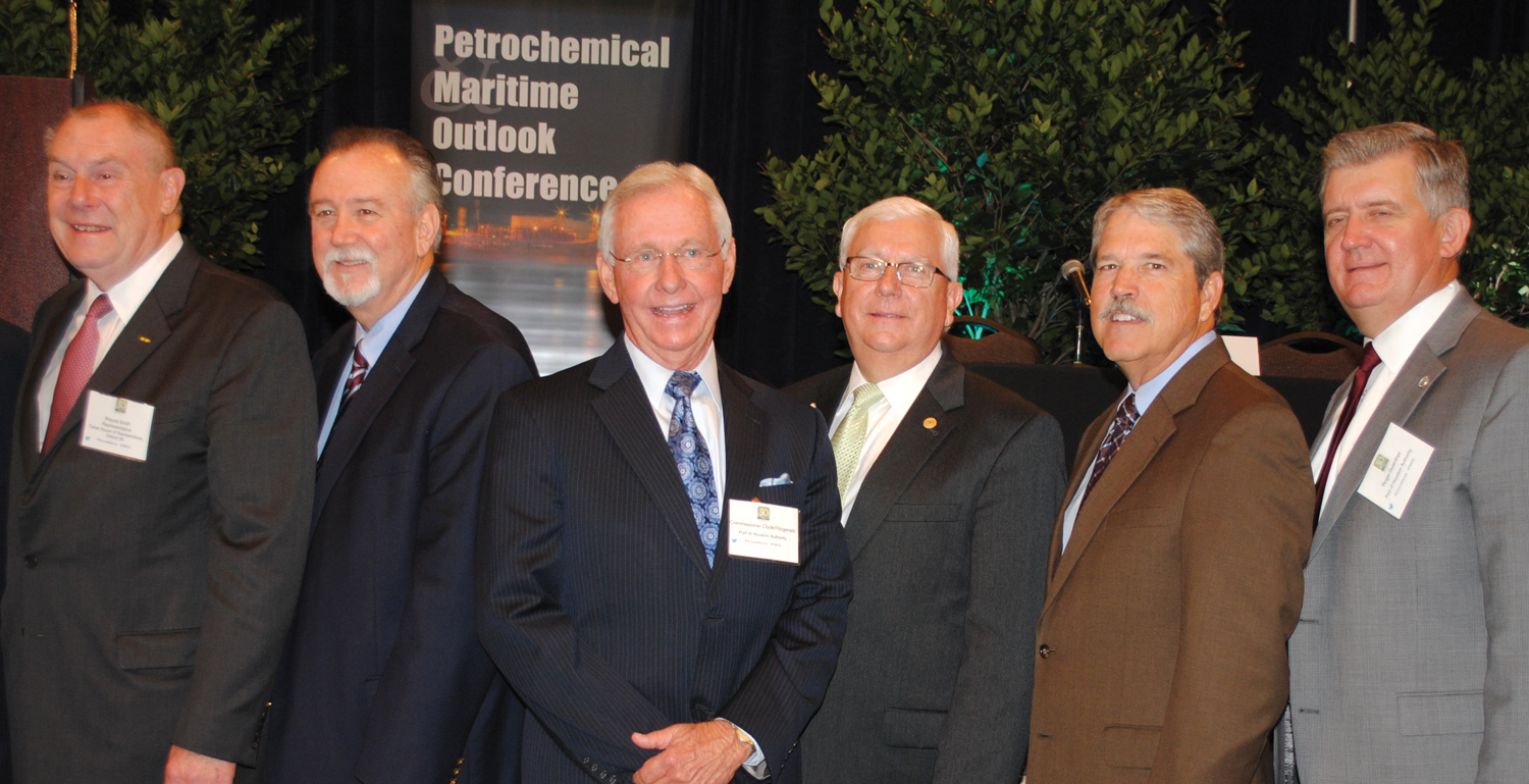 Which way do we turn? That was the question as, from left, State Rep. Wayne Smith of Baytown, Port Commissioners Stephen Don Carlos of Baytown, Clyde Fitzgerald of Pasadena and John Kennedy of Nassau Bay line up with State Senator Larry Taylor and Port Executive Director Roger Guenther for photographers during a break at the Petrochemical & Maritime Outlook Conference.