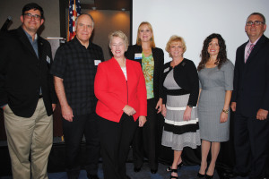Houston Mayor Annise Parker, third from left, stops for a photo with Clear Lake Area Chamber officials including, from left, Chairman Jamieson Mackey, Good Shepherd Church Pastor Dr. Jan Sattem, Business Division Chairman Janette Alford, President and CEO Cindy Harreld, Program Chairman Charity Ellis and Stuart Cayer of luncheon sponsor Kelsey-Seybold Clear Lake.