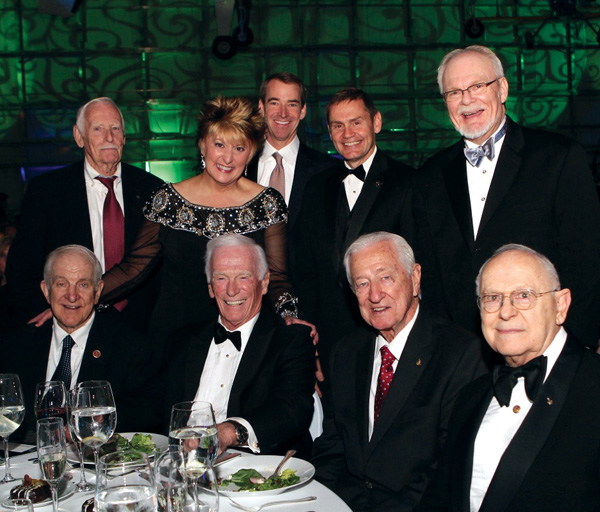 Frontiers of Flight Museum Director Cheryl Sutterfield Jones and her husband, Museum Curator Ron Jones, standing at far right, visit with some of the dignitaries at the 2013 Space Gala in Dallas, including, from left, seated, Congressman Sam Johnson, former astronaut Eugene Cernan, Congressman Ralph Hall and former astronaut Alan Bean; back row, Gene Horton, one of the first members of the Space Task Group, and his son, Board Chairman and American Airlines President Tom Horton; and Boeing Aerospace Vice President John Elbon.
