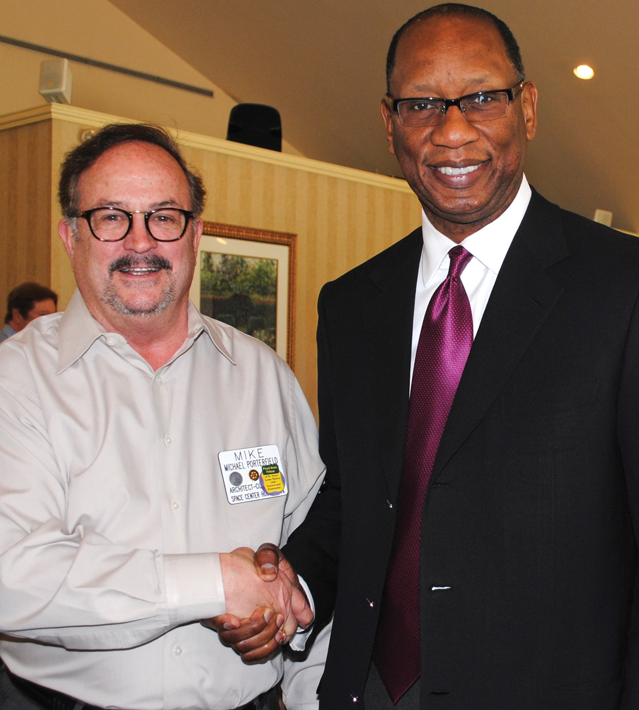 Architect Michael Porterfield, left, welcomes attorney Ben Hall and recent Houston mayoral candidate to the Space Center Rotary luncheon featuring a talk on high speed rail by Judge Robert Eckels. Photo by Mary Alys Cherry