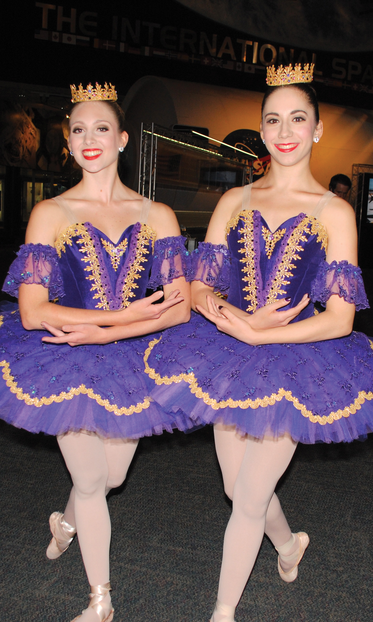 Ballerinas Brooke Carothers, left, and Millie Becker greet the arriving crowd at Space Center Houston for the Bay Area Houston Ballet & Theatre season kickoff.