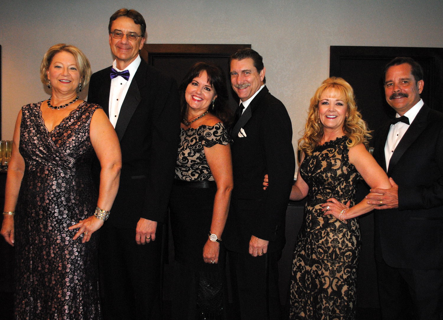 Jim and Diane Overman, Brian and Danette Spriggs and Ann and Kevin Brady, from left, are ready to party as they arrive at South Shore Harbour Resort for the Turning Point gala.