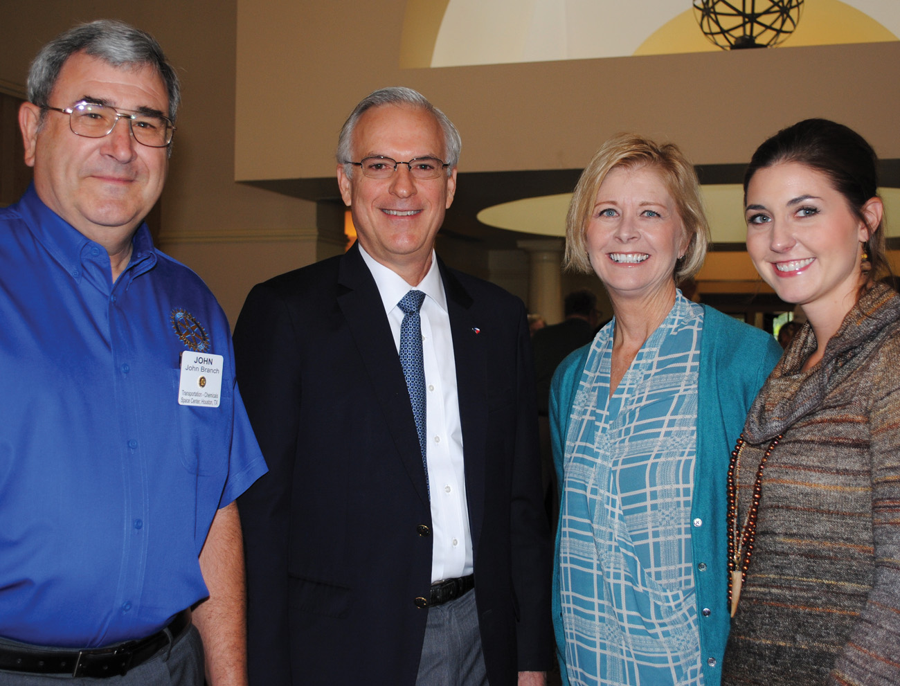 Judge Robert Eckels, second from left, arrives at the Space Center Rotary Club luncheon at Bay Oaks Country Club in Clear Lake, where he is welcomed by President John Branch, from left, Past President Sheryl Berg and Lauren Laake of Councilman Dave Martin's office. Photo by Mary Alys Cherry