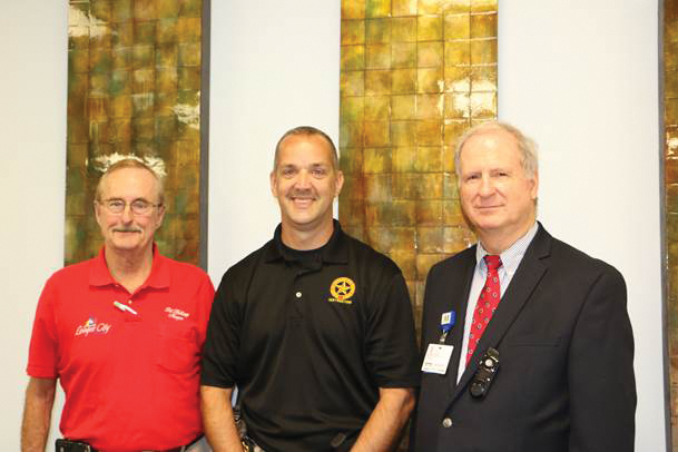 League City Police Lt. Cliff Woitena, center, accompanied here by League City Mayor Pat Halliey, left, spoke recently at two local seminars to educate the public on how to deal with an active shooter. The first, on keeping sacred spaces safe, was hosted by Houston Methodist St. John Hospital with about 60 clergy and religious leaders attending and was led by the Rev. Richard Maddox, right, director of spiritual care at St. John. The second at South Shore Harbour Resort, and hosted by the Clear Lake Area Chamber and the Bay Area Houston Economic Partnership, open to the public.