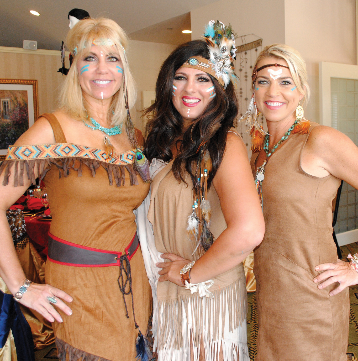 """Three Indian maidens, Michelle Richardson, Lisa Peters and Jill Smith, from left, say """"It's All About Our Reservation"""" as they enjoy the Museum Guild's Pretty Tables luncheon."""