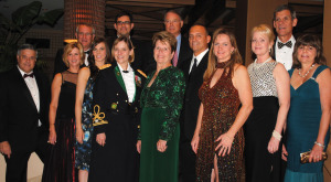 Clear Creek ISD Superintendent Dr. Greg Smith, far left, joins the Clear Creek Education Foundation honorees for a photo as the 2014 Gala gets under way at South Shore Harbour Resort. They are, from left, John and Melinda Wycoff, Caycee Black, Jamieson Mackey, in back, Col. Eugenia Guilmartin, Dr. Sandra Mossman, Dr. C. Lynn Davis, Tony and Sharon Bloomfield, Catherine Sliva and her husband, Glenn, and Dr. Cindy Castille.