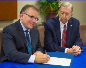 New Texas Chiropractic College President Dr. Brad McKechnie, left, goes over plans for the coming year with TCC Board of Regents Chairman Dr. Monte Blue.