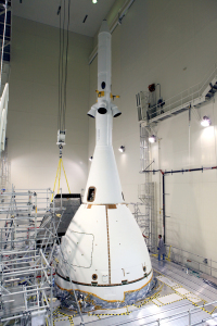 A crane brings the fourth and final Ogive panel closer for installation on Orion's Launch Abort System inside the Launch Abort System Facility at NASA's Kennedy Space Center in Florida.