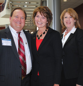 San Jacinto College Chancellor Dr. Brenda Hellyer, center, and Vice Chancellor Teri Crawford thank Bay Area Houston Economic Partnership's Dan Seal for his help with the State of the College Program, presented to the community at San Jac South.
