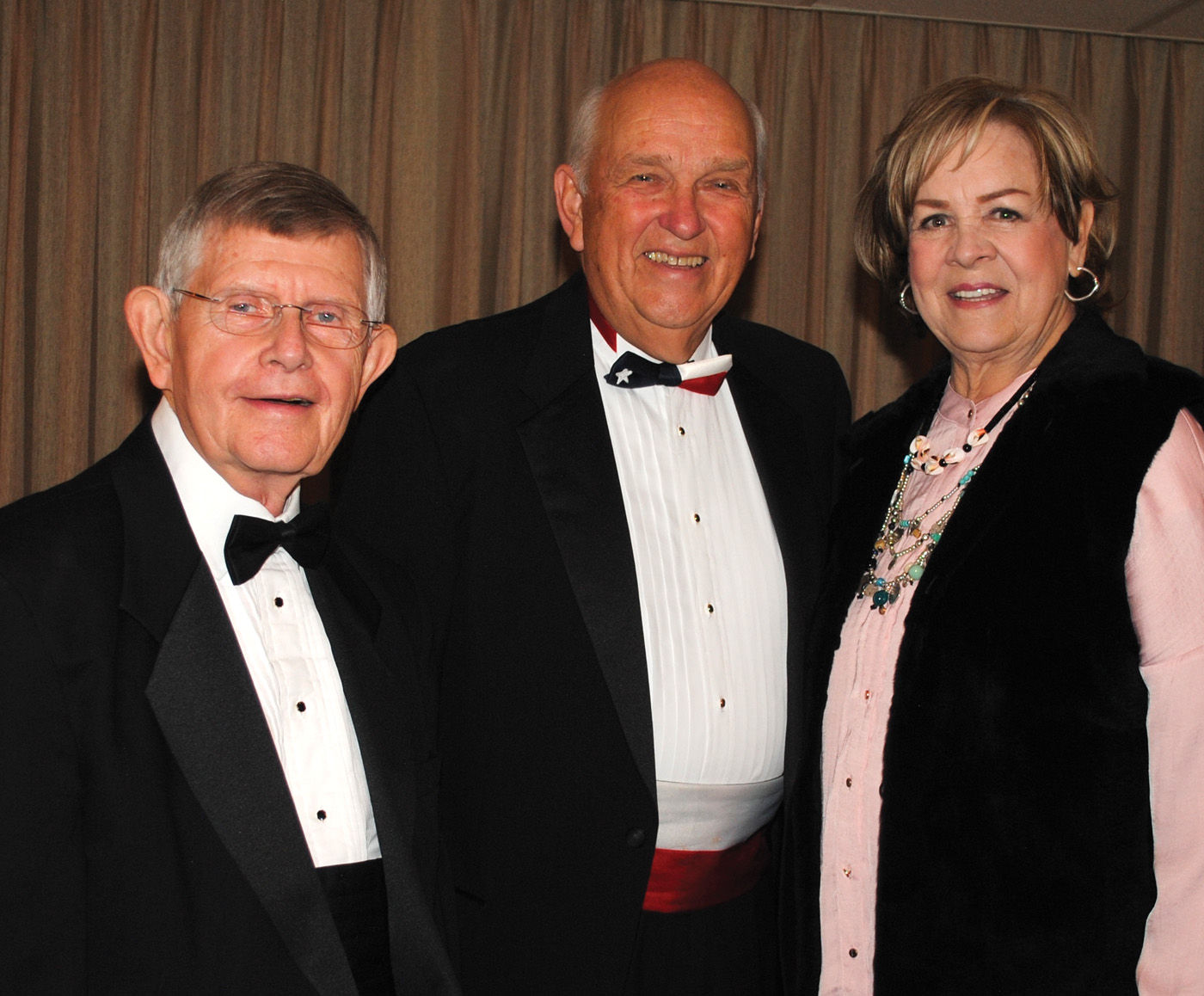 Attorney Joe Barlow, left, the George Carlisle Distinguished Service Award winner, joins Citizen of the Year Harv Hartmen for a photo with Ann Hacker, the Dennis Johnson Memorial Small Business Award winner at the CCEF Gala.