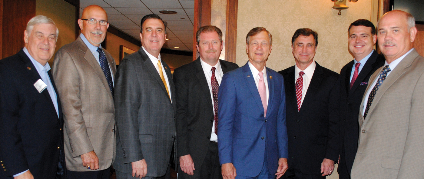 BAHEP President Bob Mitchell, right, welcomed a number of elected officials to the reception featuring an address by Congressman Brian Babin. Joining him are, from left, Mayors Jon Keeney of Taylor Lake Village and Michel Bechtel of Morgan's Point, State Rep. Dennis Paul, Galveston County Commissioner Ken Clark, Dr. Babin, Seabrook Mayor Glenn Royal and Galveston County Commissioner Ryan Dennard.