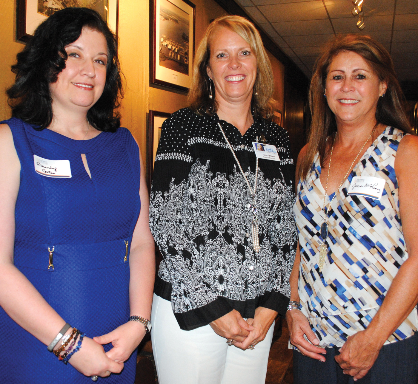 Brandy Gates of UTMB, Janet Brown of Space Center Houston and Joan McKinney of Norman Frede Chevrolet, from left, arrive at Lakewood Yacht Club for the BAHEP reception.