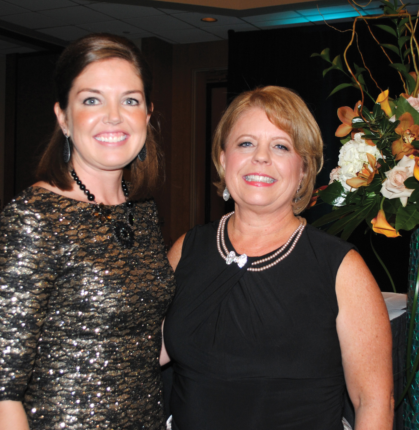 CCEF Executive Director Kaci Hanson, left, congratulates Gala Chairman Teresa Vencil on a very successful evening.