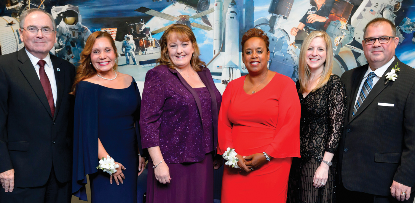 "Four alumni and a university professor were honored at the University of Houston-Clear Lake's 2016 Alumni Celebration at Space Center Houston. Here, UHCL President William A. Staples, from left, joins the honorees for a photo -- Evelyn Miralles (Distinguished Alumna), Christine ""Christy"" Harper (Distinguished Alumna), Lisa A. Jones (Outstanding Professor), Kristi Koncaba (Early Achievement) and Robert C. Hasson Jr. (Marilyn S. Sims Leadership Service Award)."