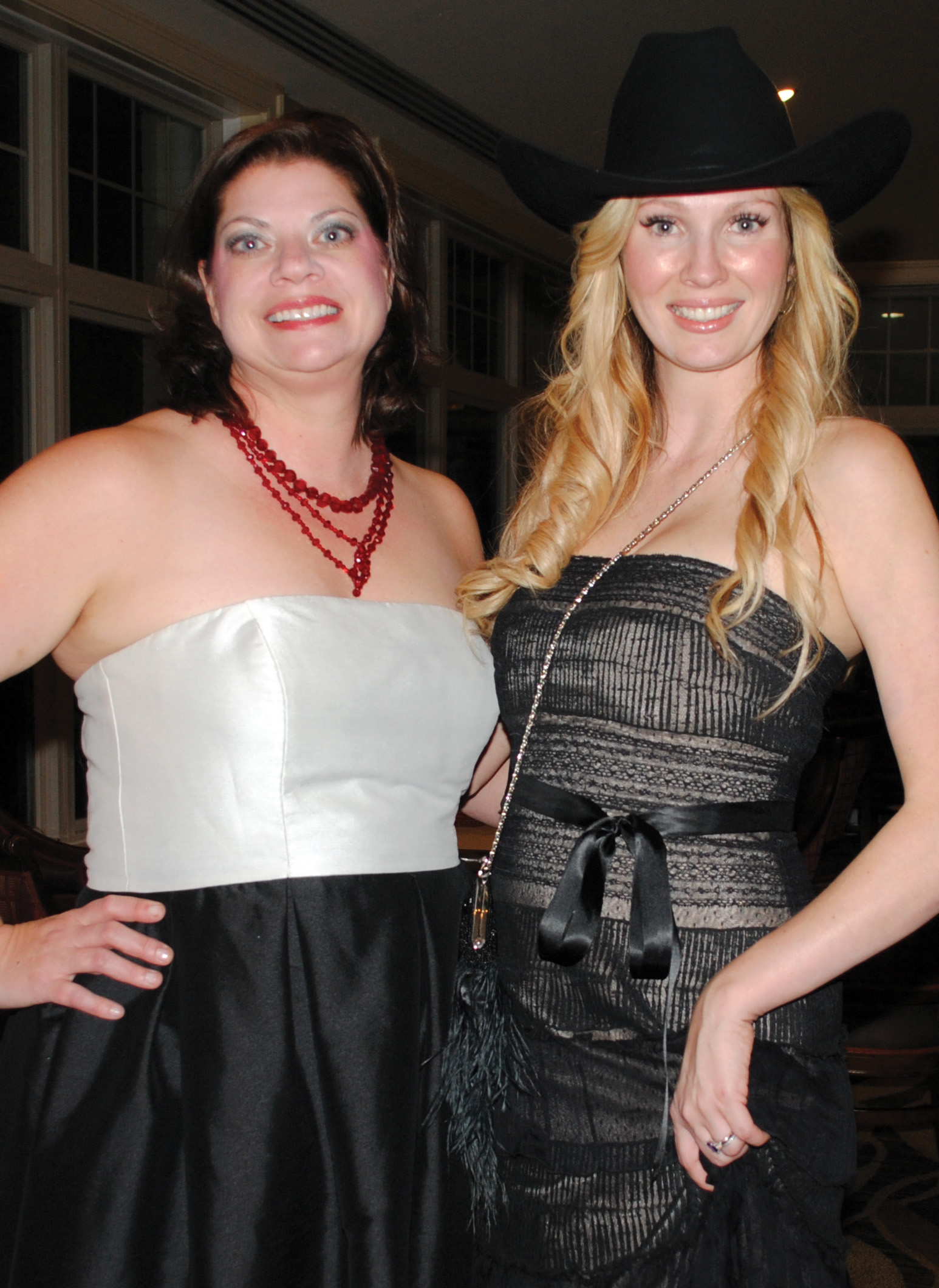 Gala Co-Chairman Melissa McKinnie, left, and Lea Bodie prepare to welcome the crowd to Bay Oaks Women's Assocation Gala.