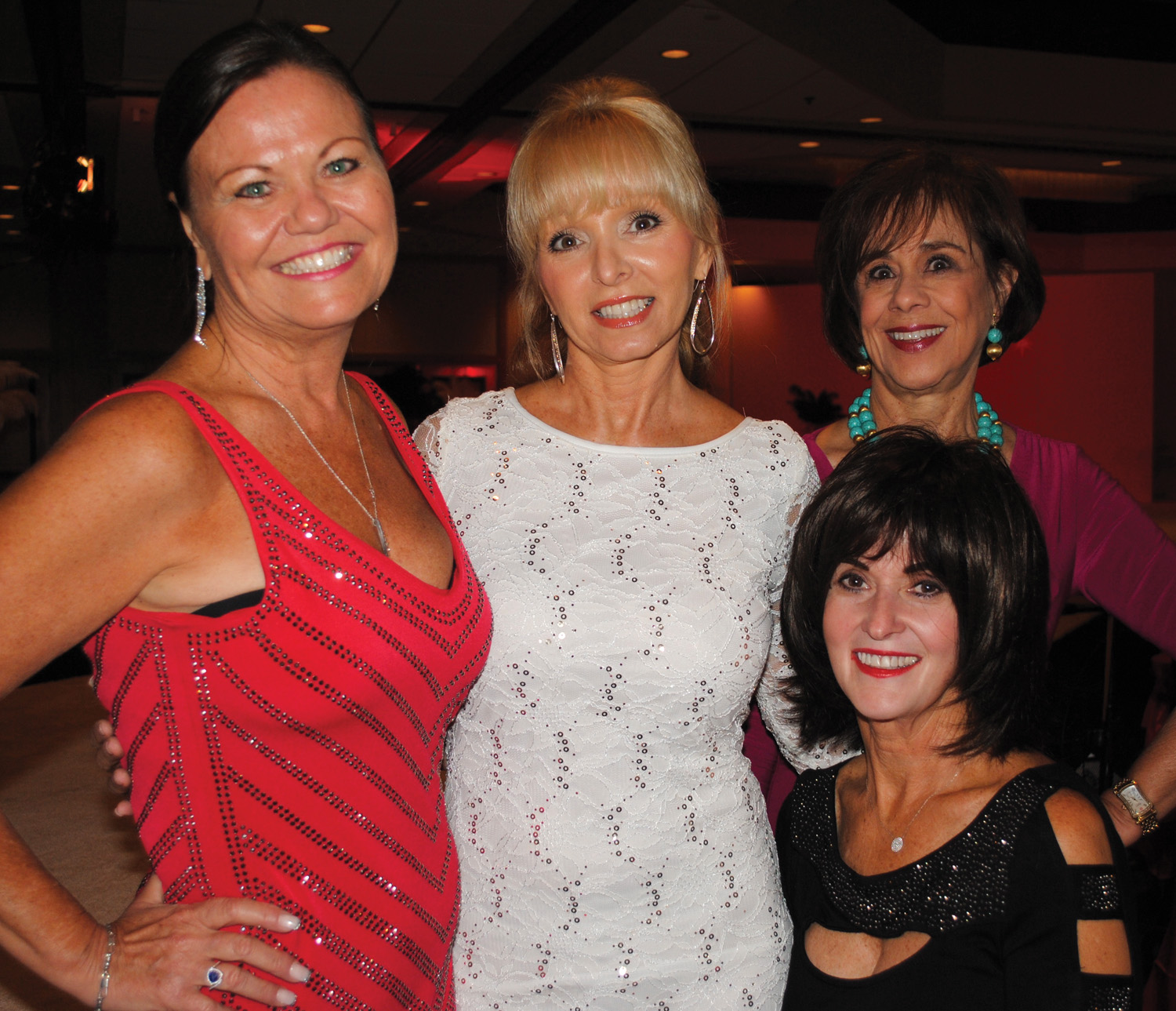 Kimberly Flemming, Tama Brantley, Ginger Pampolina, from left, and Ann Blanchard, seated, were among the many at Panhellenic's Glamour and  Glitz Vegas Style Fashion Show at South Shore Harbour Resort.