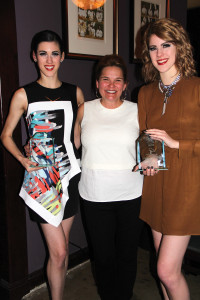 Vanessa Handrick Garner, center, is happy to see Jete' Award winners, Laura, left, and Alison Henning, as they arrive at the party at Tommy's after performing in the Tribute to Handrick's mother, the late Lynette Mason Gregg.