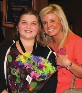 Whitcomb Elementary student Brooklyn Krell gets a big hug from her mother, Cassandra Tucker, after being the first of five in her fifth grade class to be knighted during the school's Jan. 12 Knighting Ceremony for their excellent behavior.