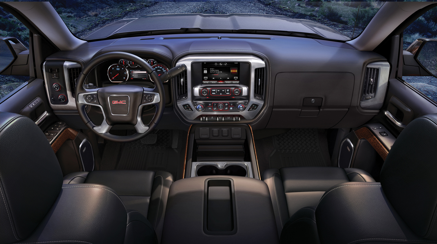 2015 GMC Sierra SLT Interior front dash view from the rear seats