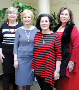 Hospitality Committee members await the arriving crowd for the Bay Oaks Women's Association Luncheon. They are, from left, Fran Gentry, Chalrman Judie Ferguson, Jo Cat Bruce and Danele Buehlar.